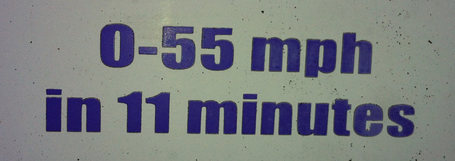 "Bumper Sticker reading ""0 to 55 mph in 11 minutes)"