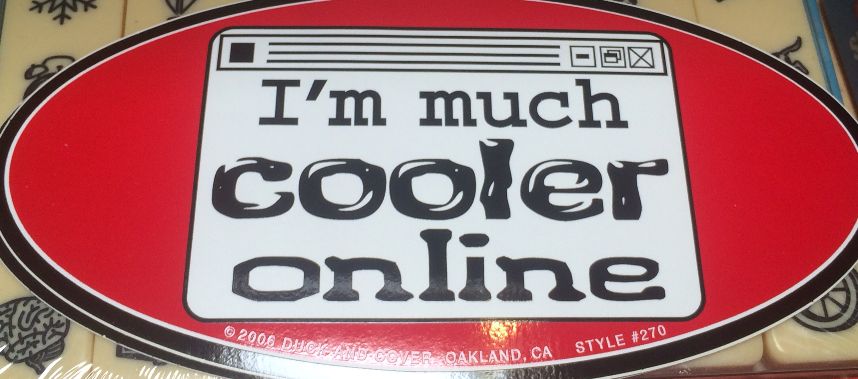 "Bumper Sticker reading ""I'm much cooler online"""